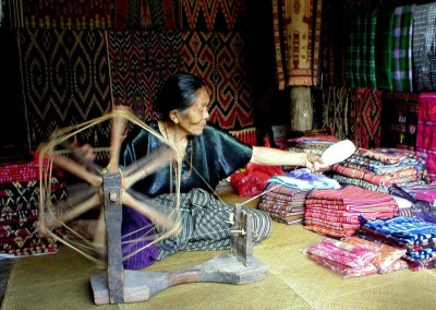 Old lady making thread